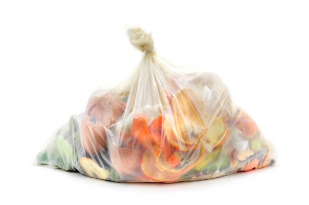 biodegradable waste in a biodegradable bag - biodegradabile foto e immagini stock