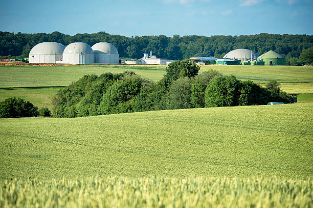 Bioenergie, Biomass energy plant in a rural landscape stock photo