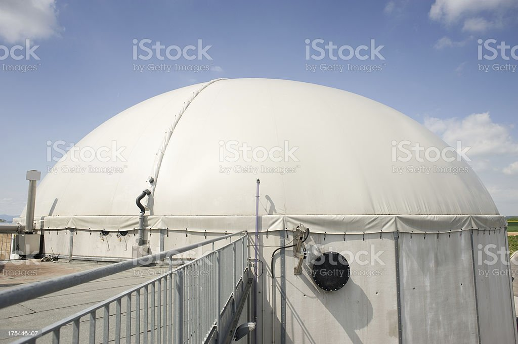 Bioenergie, Detail of a modern Biomass Plant  against great cloudscape stock photo