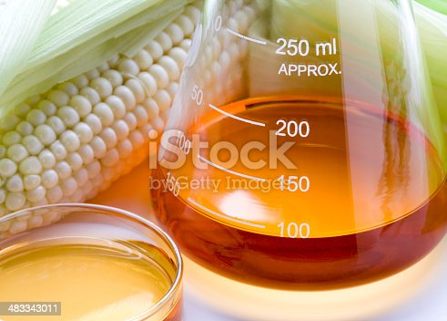 Corn and lab equipment. Concept for biofuel research.
