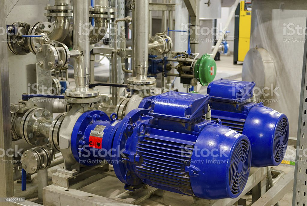 biogas equipment pipes. gas process from sludge stock photo
