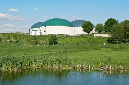 Biogas plant for agriculture, in front a biotope