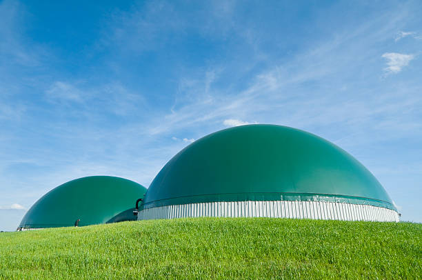 Biogas plant for electricity production in agriculture stock photo