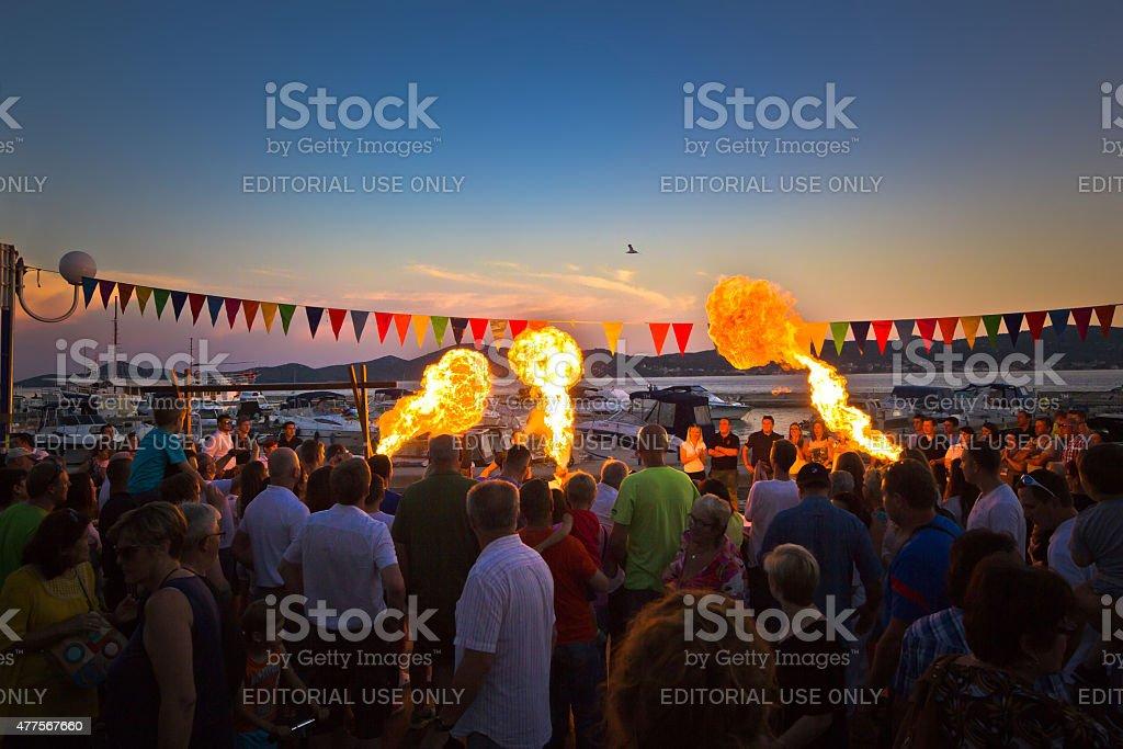Biograd fire spitter evening view stock photo