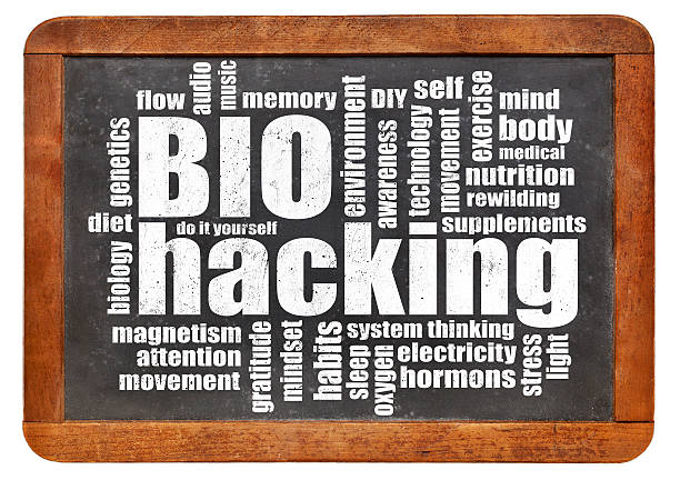 biohacking word cloud on blackboard biohacking -  managing one's own biology using a combination of medical, nutritional and electronic techniques - word cloud on a blackboard biohacking stock pictures, royalty-free photos & images
