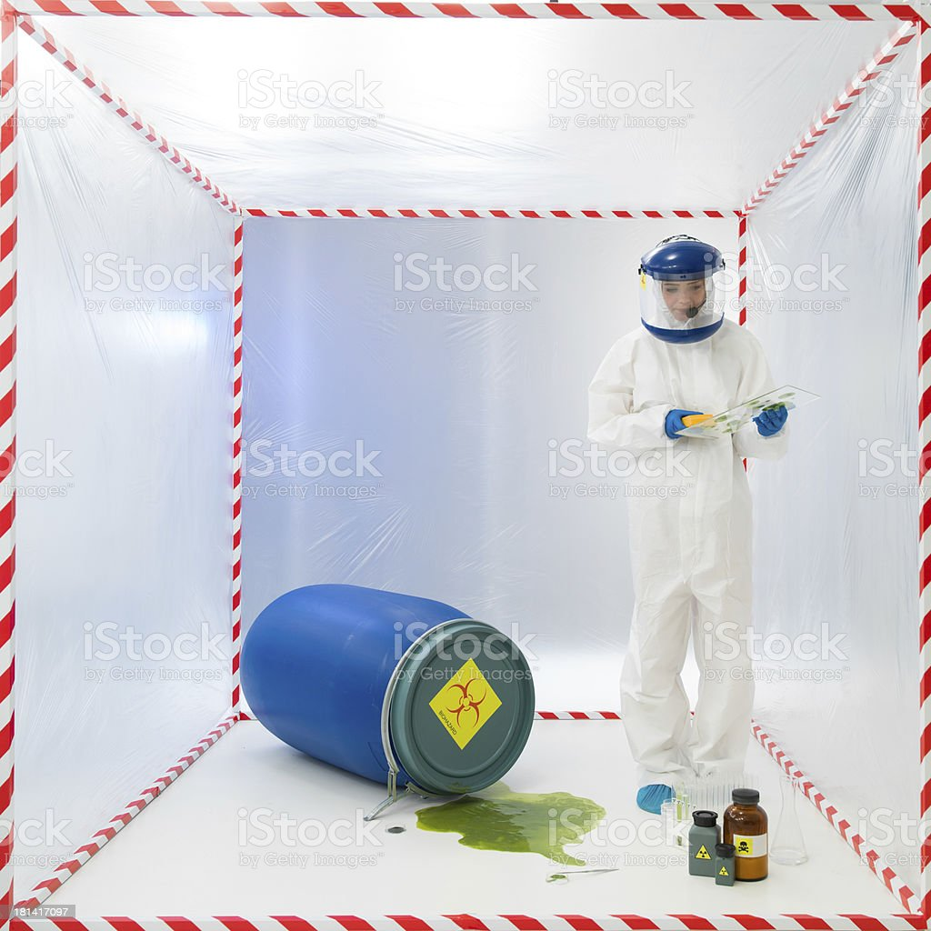Biohazard scientist testing a spillage royalty-free stock photo