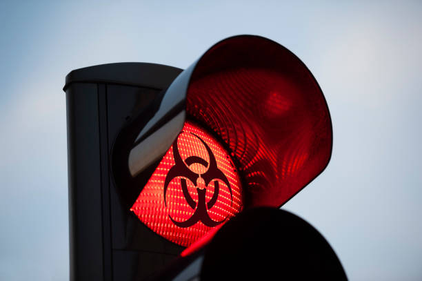 Biohazard symbol on red traffic light stock photo