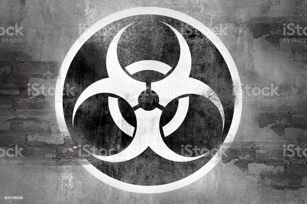 biohazard symbol on wall stock photo