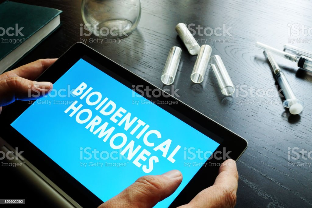 Bioidentical hormones. Doctor holding tablet with sign. stock photo