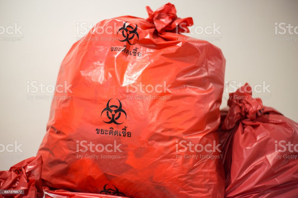 biological waste, red biohazard garbage bag stock photo