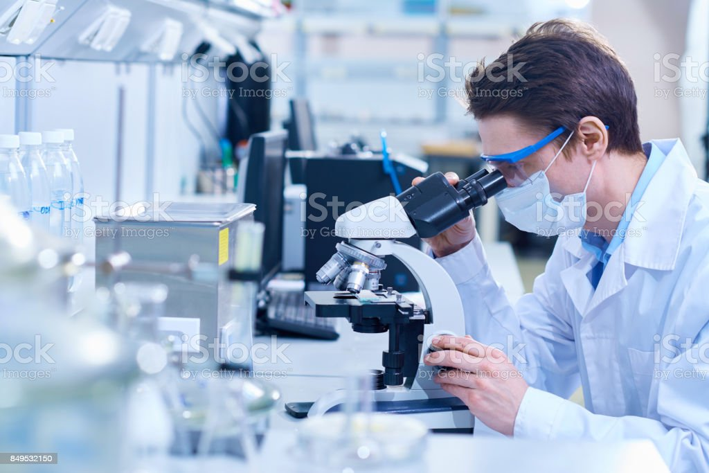 Biologist researching dangerous substance stock photo