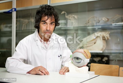 A confident look on the face of a biologist sitting in his research laboratory.