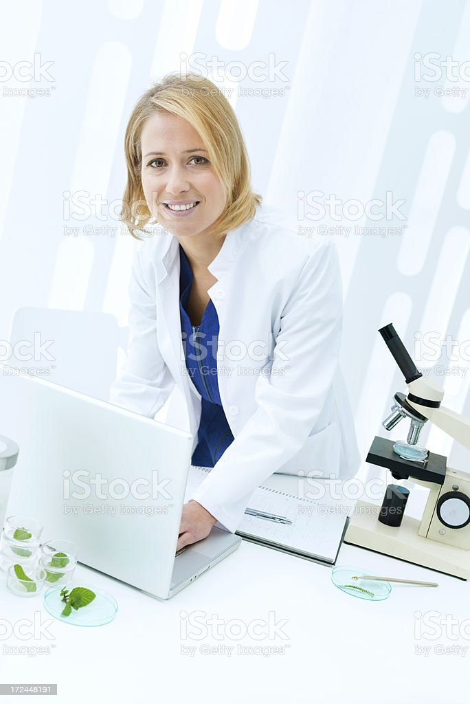 Biologist working in laboratory royalty-free stock photo