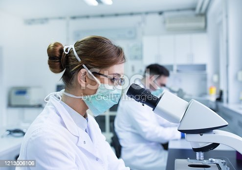 istock Biologists working with microscope 1213006106