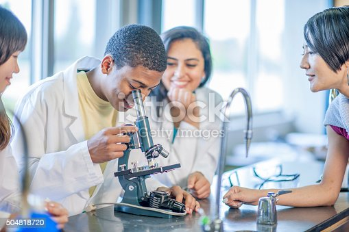 istock Biology Lab Examination with a Microscope 504818720