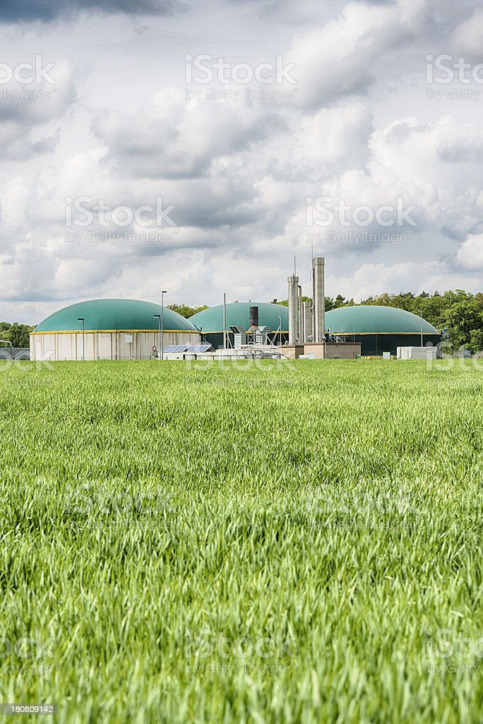 Biomass energy plant under a great cloudscape Energiewende Biogas royalty-free stock photo