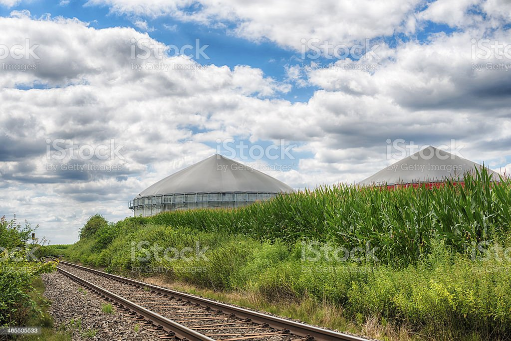Biomass energy plant under a great cloudscape Energiewende Biogas stock photo