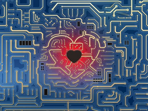 Blue PCB with a heart shape in the middle and computer chip in human heart form. 3D biomedical technology concept.