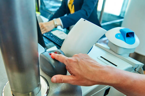 Biometric control of fingerprints in airport. Tourist passes biometric control of fingerprints in airport biometrics stock pictures, royalty-free photos & images