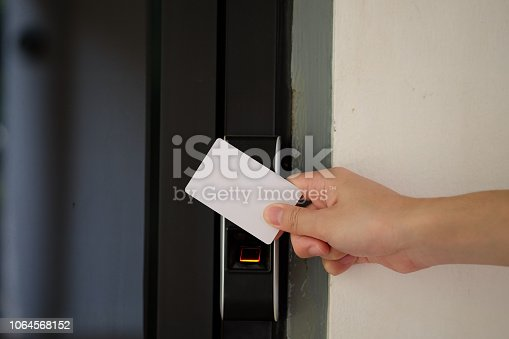 Electronic key access system with hand inserting key card to unlock door.