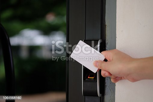istock Biometric fingerprint scanner with keycard. 1064568160