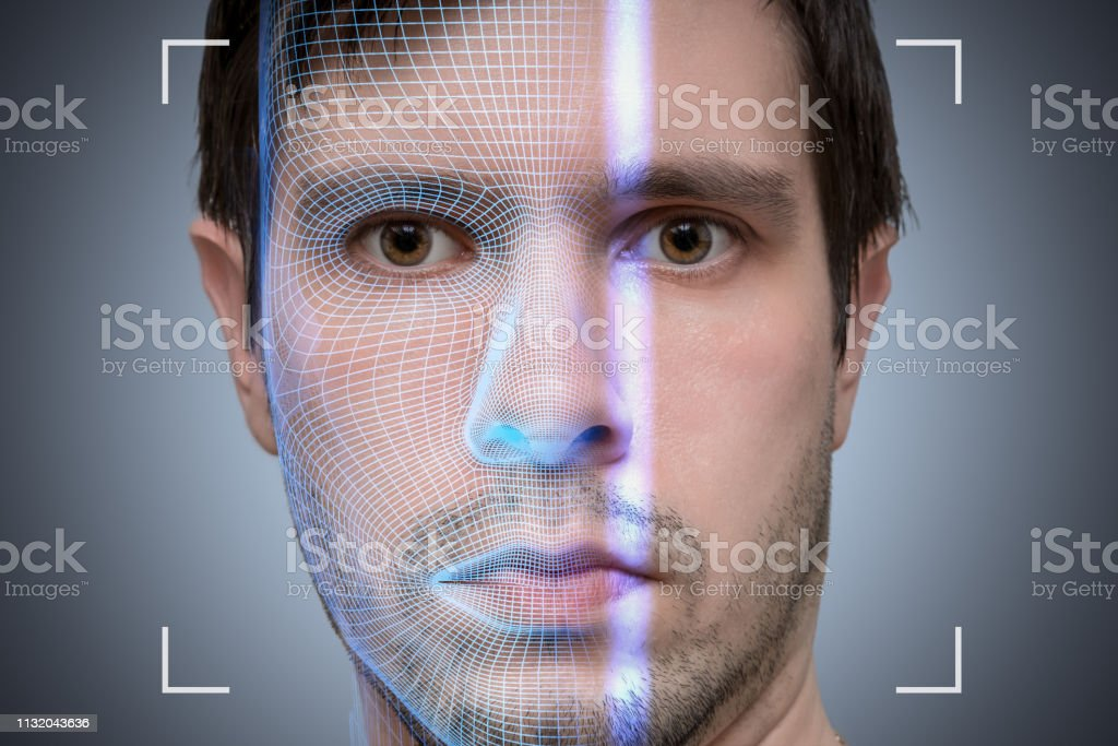 Biometric scanner is scanning face of young man. Artificial intelligence concept. Biometric scanner is scanning face of young man. Artificial intelligence concept. 3D Scanning Stock Photo