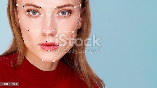 851960146istockphoto Biometric verification woman face detection 900997600