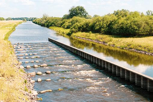 UNESCO biosphere reserve river landscape Elbe, fish ladder in Creek Sude, Boizenburg, Germany.