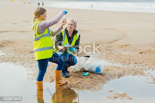 istock Biotechnology woman engineer examining Sea Water Samples 1023573470