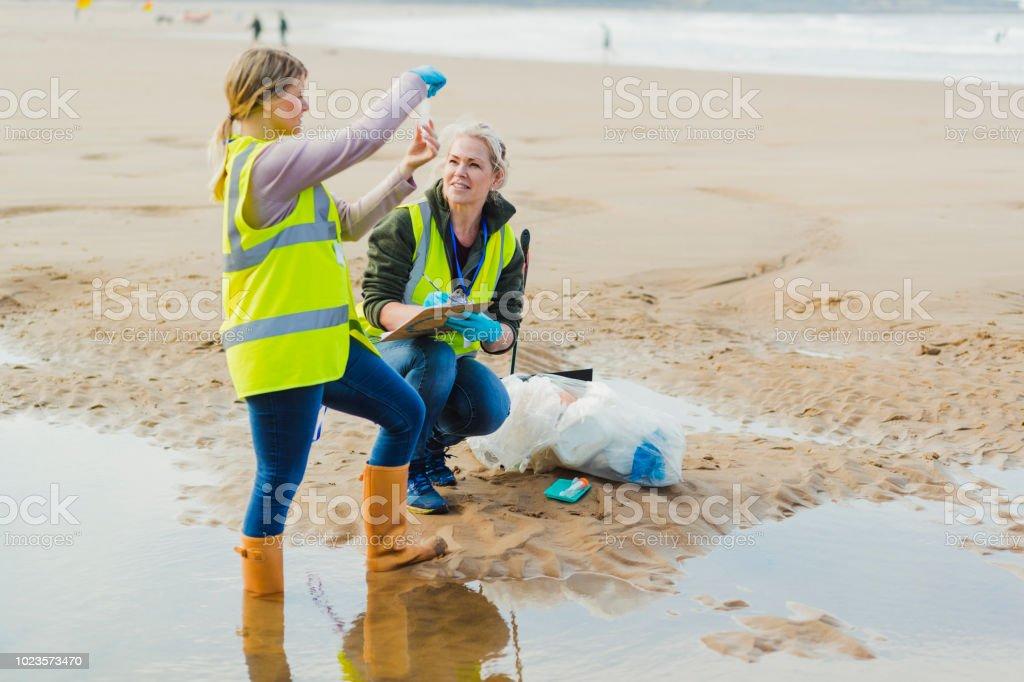 Biotechnology woman engineer examining Sea Water Samples stock photo