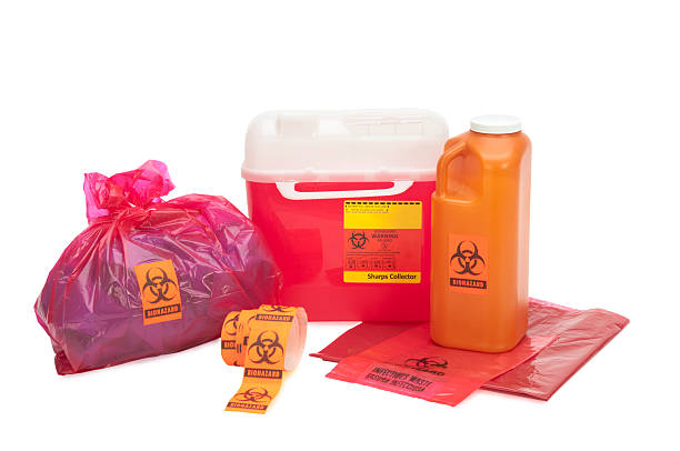 Bio-Waste with clipping path This image shows various forms of bio-waste including needle disposal container, liquid bodily waste, and bagged medical waste...all with bio-waste warnings. Background is 255 white with clipping path. toxic waste stock pictures, royalty-free photos & images