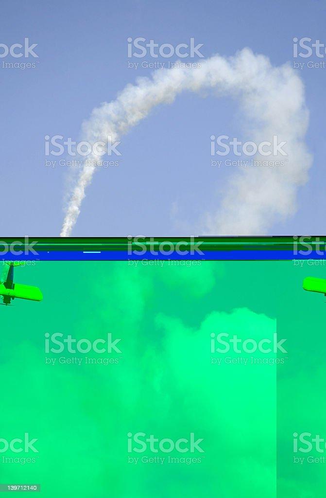 Bi-plane and Curved Smoke Trail royalty-free stock photo