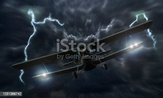 istock Biplane crash in a storm with lightning concept. Accident airplane in the sky. Emergency landing. Flights in bad weather 1251386742