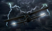 Biplane crash in a storm with lightning concept. Accident airplane in the sky. Emergency landing. Flights in bad weather