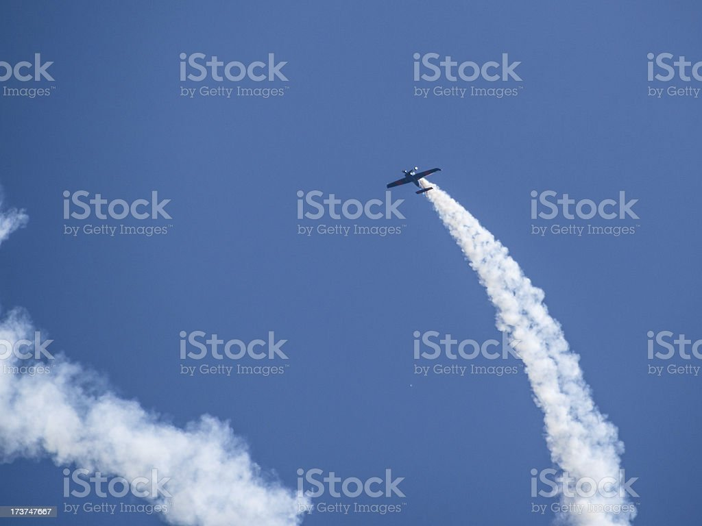 Biplane Exhaust Trail royalty-free stock photo