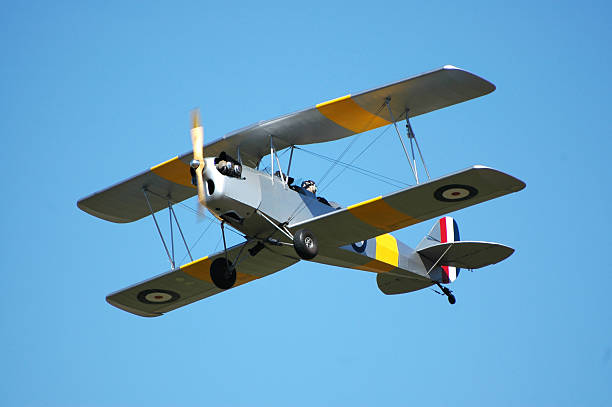 biplane R80 Tiger Moth flying in clear blue sky stock photo