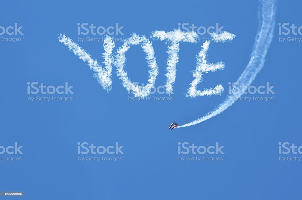 Biplane Sky Writing Vote royalty-free stock photo