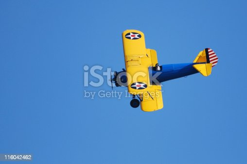 World War II trainer aircraft in original 1940s US Army paint scheme. Stearman PT-17 Kaydet.