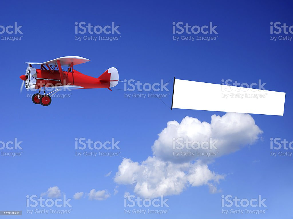 Biplane with Banner royalty-free stock photo