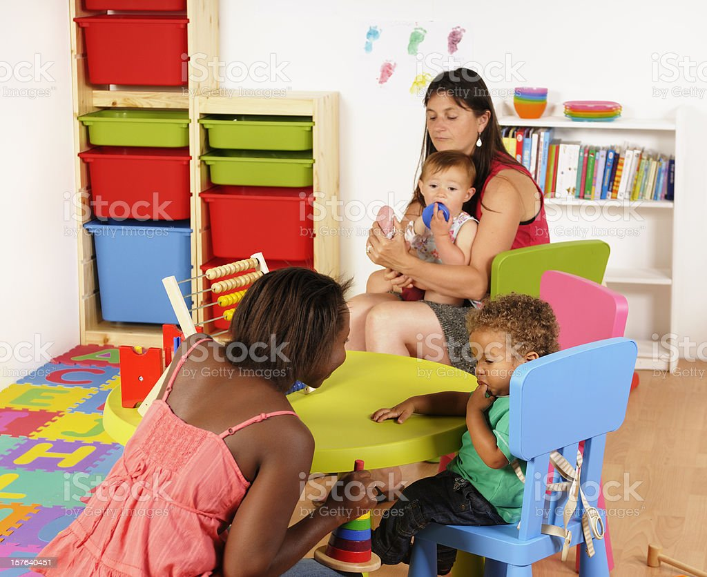 Biracial Baby Boy Sucking His Finger During Playtime royalty-free stock photo