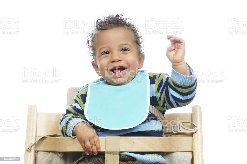 Biracial Baby Showing His Excitement Before A Meal stock photo