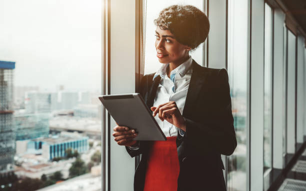 Biracial businesswoman and tablet pc stock photo