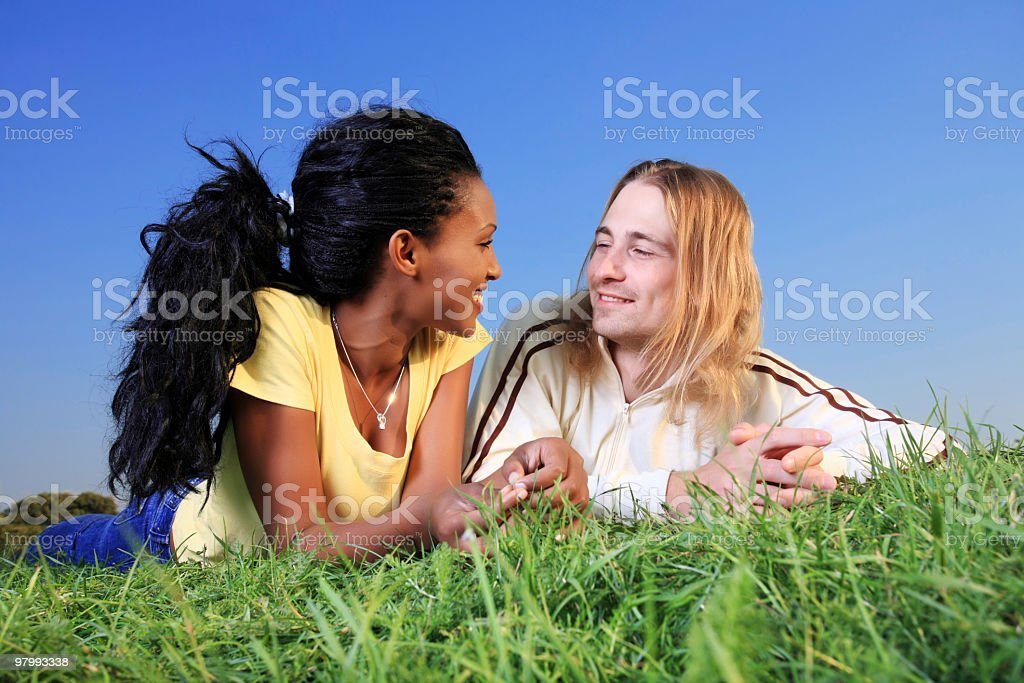 Biracial couple resting outdoor. royalty-free stock photo