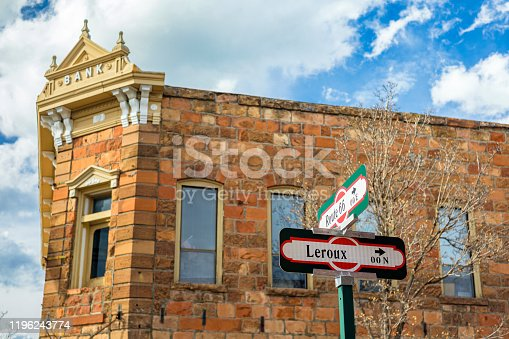 Cityscape view of historic Route 66 and Leroux street signs in Flagstaff, Arizona.