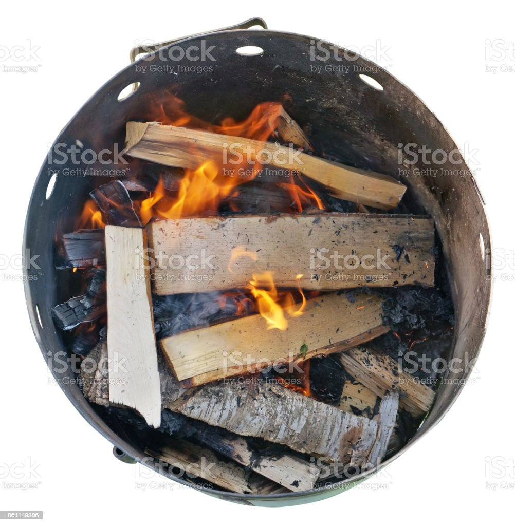 Birch firewood and logs burn in a steel barrel. The barrel will be used for cooking pilaf. royalty-free stock photo