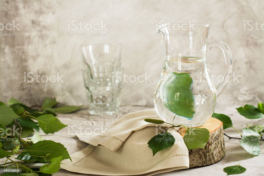 Birch sap in a glass jar stock photo