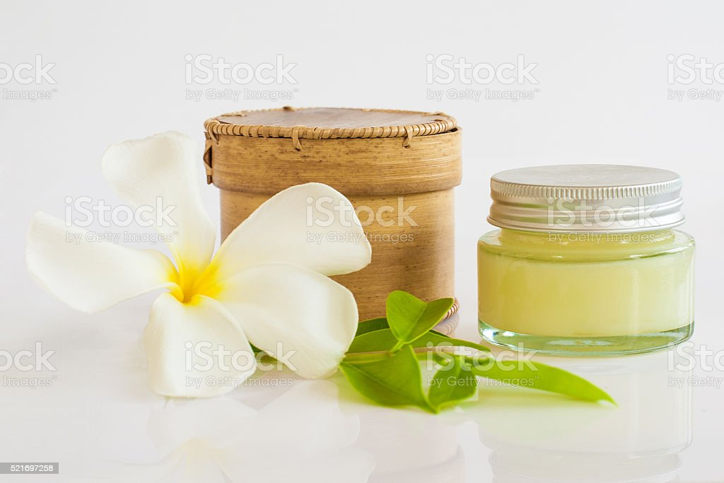 Birch-bark cosmetic box and cosmetic cream isolated on white. stock photo