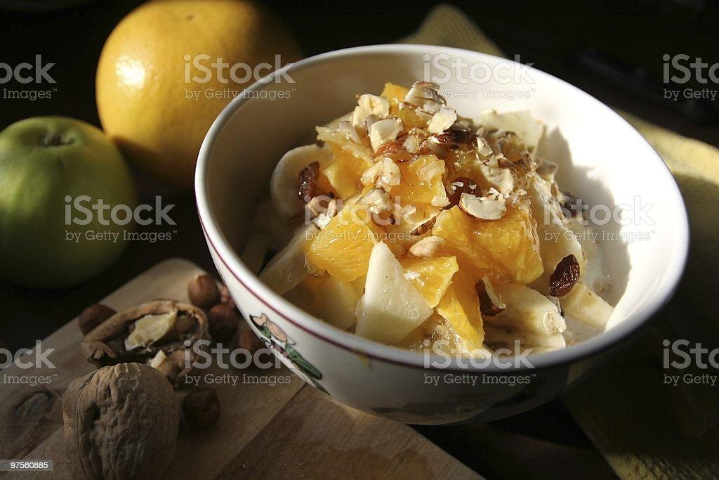Bircher Muesli in breakfast bowl, morning dawn royalty-free stock photo
