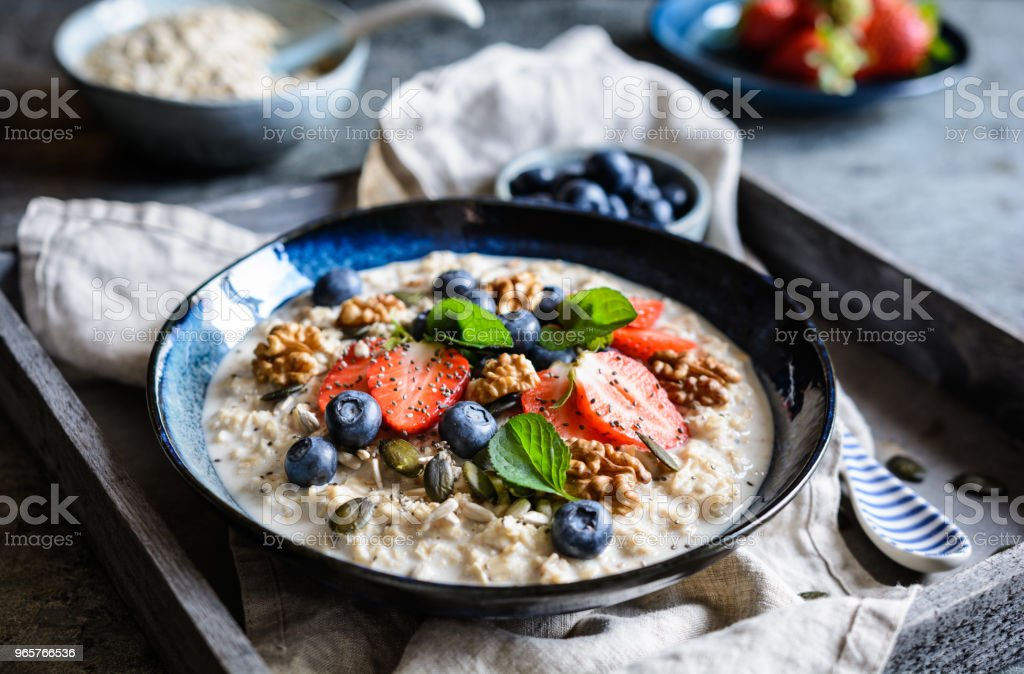 Bircher muesli with strawberries, blueberries, chia seeds, walnuts, sunflower seeds and pumpkin seeds - Royalty-free Blueberry Stock Photo