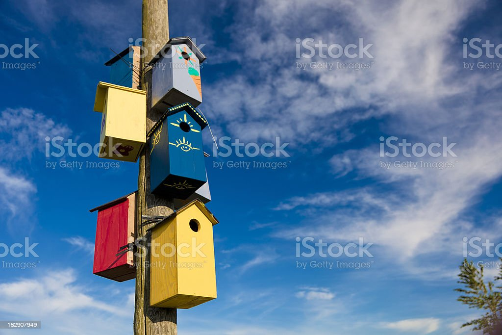 Bird cage on a wooden pole stock photo